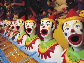 Amusement park game clowns with mouths open