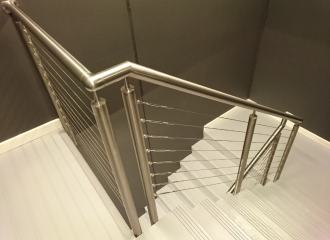 Modern fire stairs, view down from landing of handrail